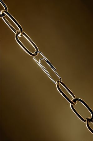 Weak chain with a paper clip Stock Photo - 919204