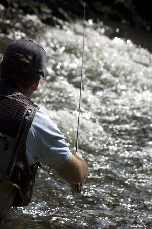 Fisherman fishing on a river photo