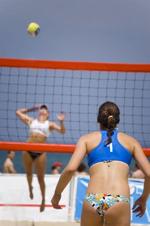 Young girls playing volleyball in the beach Stock Photo - 1355660