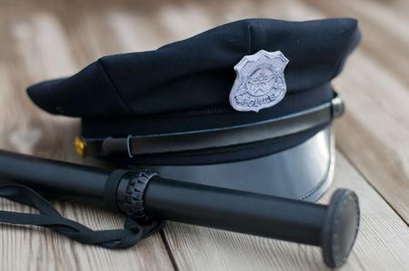 Police equipment. Hat and truncheon Stock Photo