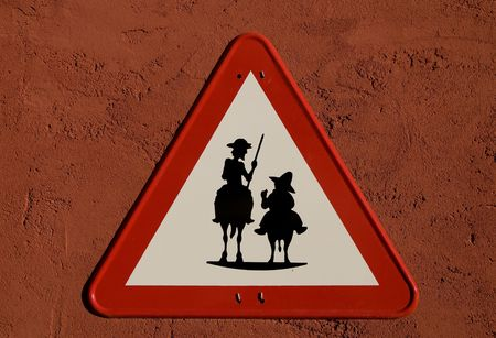 don: Don Quijote and Sancho Panza silhouette in Traffic Sing Stock Photo