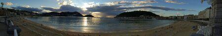 san sebastian: Panoramic view. Concha Bay and Concha Beach at twilight. San Sebastian. Spain. Santa Clara Island, Urgull Mountain and Igueldo Castle in background.