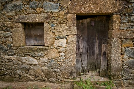 Aged wooden door and window in an ancient house Stock Photo