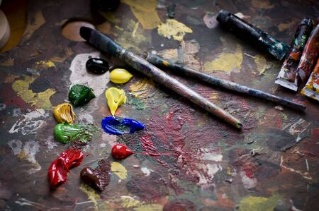 color color palette: Painters brushes and old pallet