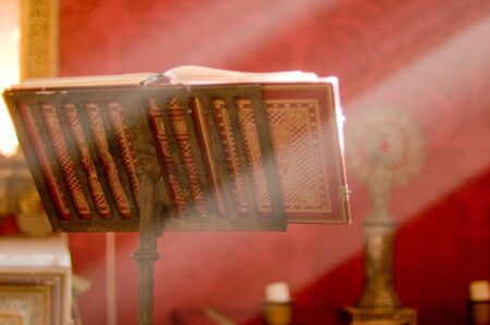 lectern: Lectern in altar with a holy bible and a ray of divine light.