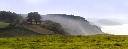 Panoramic Mountain Landscape with the Ocean in background. Asturias, Spain photo