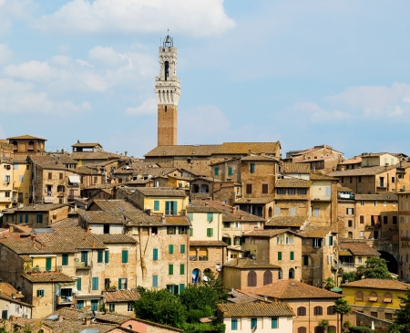 siena italy: Siena view with antique houses and Mangia tower  Siena, Italy Stock Photo