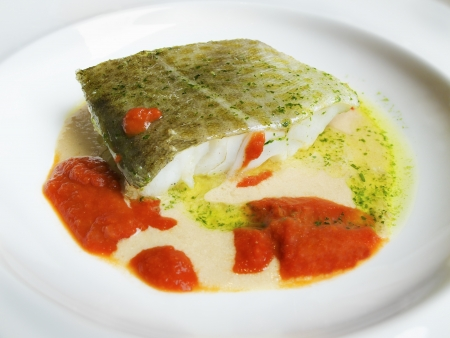 cantabrian: Cod in green sauce and tomato sauce, Basque cookery  Stock Photo