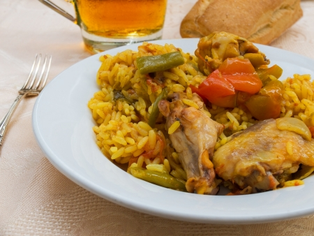 spanish culture: Typical and authentic spanish Paella tapa with chicken and rabbit   No fish or shellfish  Stock Photo