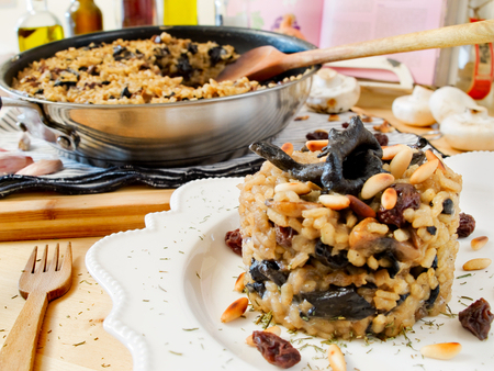 raisins: Risotto with mushrooms, raisins and pine nuts