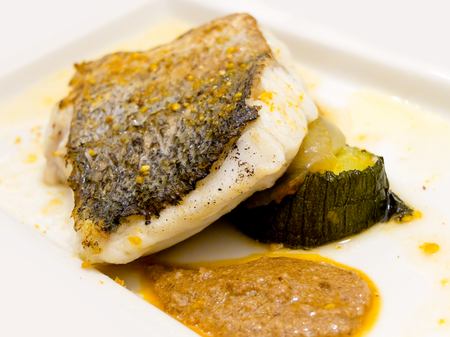 san sebastian: Pan-fried gilt head bream with peppers sauce. Stock Photo