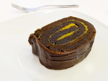 swiss roll: Chocolate and custard swiss roll  Brazo de gitano  Stock Photo