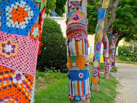 bombing: Yarn bombing in a trees. European park. Editorial