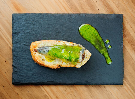 san sebastian: Typical spanish sardine skewer in slate plate. (Sardine pintxos)