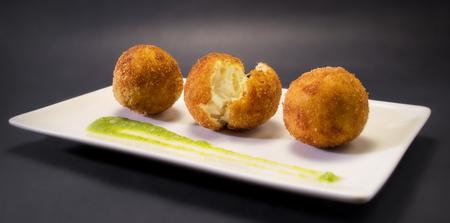 Creamy and smooth fried croquettes. Traditional Spanish cuisine.