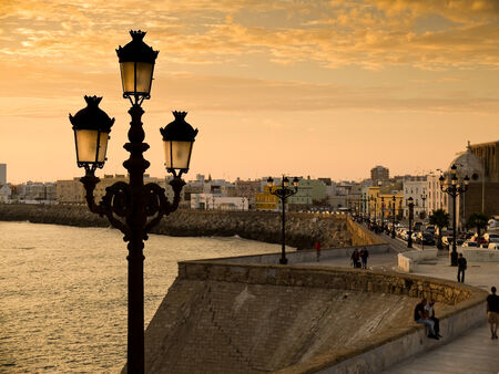 lampost: Paseo Campo del Sur in Cadiz at sunset. Andalusia, Spain Stock Photo