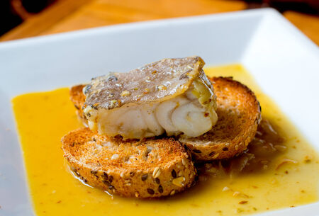 san sebastian: Typical spanish codfish tapa cooked at low temperature.