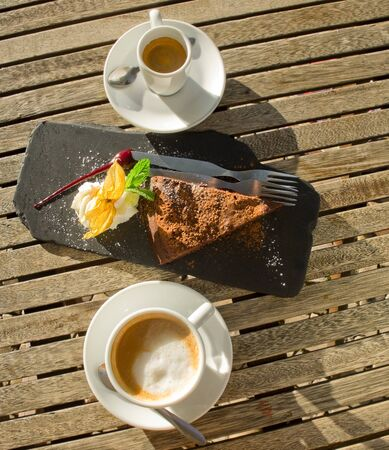 coffees: Dark chocolate cake and coffees. Stock Photo