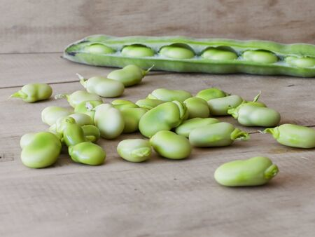 Ecological broad beans in a rustic table.
