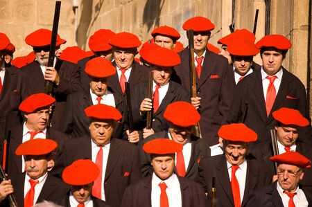 boast: Irun Spain June 30 2007. Thousands of Citizens wearing uniforms and Organised into Their respective companies each with barmaid and wearing red berets. The boast of San Marcial in Irun. Guipuzcoa SpainThe boast of San Marcial in Irun commemorates the vict Editorial