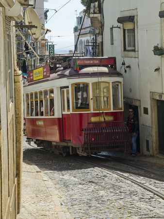 tramcar: February 27 2015 Lisbon Portugal Lisbon Hills Tramcar Tour in Alfama district. The red line is the tourist That line connects the hills of the city. Lisbon Portugal. Editorial