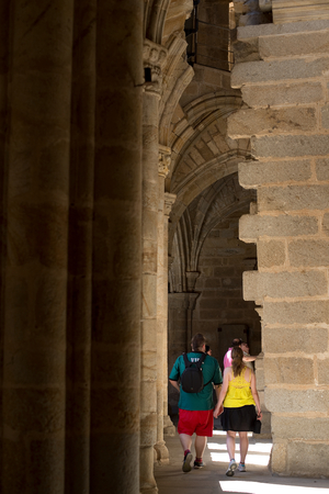 Plasencia Spain 16 May 2015: Group of tourists visit the cloister of Cathedral of Santa Maria Caceres of Plasencia Extremadura. Spain