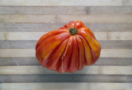 ecologic: Fresh ecologic beefsteak tomato in a rustic table.