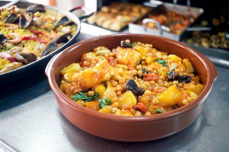 potato cod: Spanish chickpeas with cod. Rustic Mediterranean style cuisine.