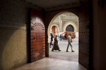 bab: People walking in front of The Bab el Mansour gate, view from inside a entry hall of a classical building. Bab Mansour, built in 1732, it is considered one of the most beautiful works of Moulay Ismael.  Editorial