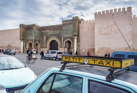 bab: With Petit Taxis Taxi rank front of The Bab Mansour in the medina of Meknes. This gate is one of the most beautiful works of Moulay Ismail and the largest in Morocco