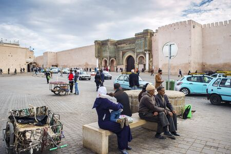 bab: People front of The Bab Mansour in the medina of Meknes. This gate is one of the most beautiful works of Moulay Ismail and the largest in Morocco Editorial