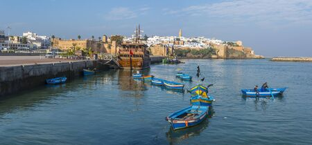 ocean fishing: Fishing boats in Rabat fishing port, is located on the Atlantic Ocean at the mouth of the river Bouregreg, close to Kasbah of the Udayas in background. Rabat.