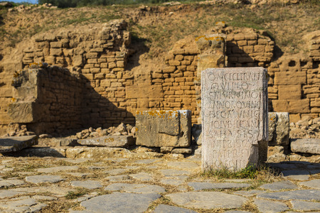 pillage: Remains of headstone in archaeological site of the Roman city known as Sala Colonia in Chellah. Chellah is the necropolis of Rabat. Morocco. Stock Photo