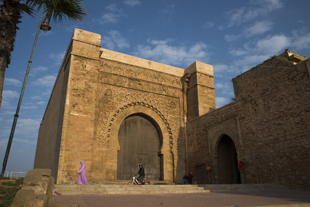 bab: People with djellaba walking in fron of Bab el Kebir. Main gate of Kasbah of the Udayas, a small fortified complex and a symbol of the Almohad arquitecture. Rabat, Morocco. North Africa. Editorial