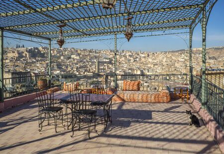 arbour: View of the rooftops of the Fez medina from a terrace iron arbour. Fez, Morocco. North Africa.