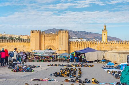 exterior shape: Market in Bab Chorfa at sunset, view from Bou Jeloud square. Bab Chorfa is a gate to ancient Fez El Bali Medina. Fez, Morocco. North Africa.