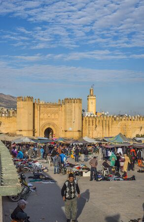 fez: Market in Bab Chorfa at sunset, view from Bou Jeloud square. Bab Chorfa is a gate to ancient Fez El Bali Medina. Fez, Morocco. North Africa.