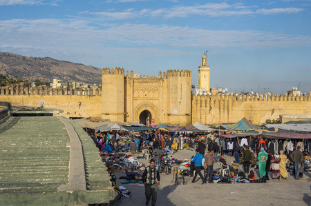 bab: Market in Bab Chorfa at sunset, view from Bou Jeloud square. Bab Chorfa is a gate to ancient Fez El Bali Medina. Fez, Morocco. North Africa.