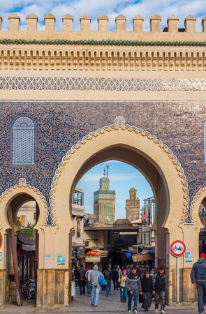 bab: Fez, Morocco - December 14, 2015:  Bab Bou Jeloud. The blue gate is a gate to ancient Fez El Bali Medina. Fez, Morocco. North Africa.