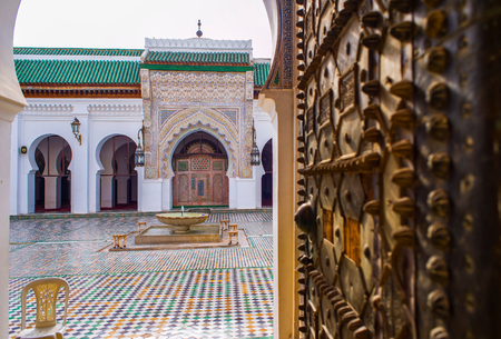 north africa: Entrance of the University al-Qarawiyyin or al-Karaouine. Fez El Bali Medina. Fez, Morocco. North Africa. focus in background