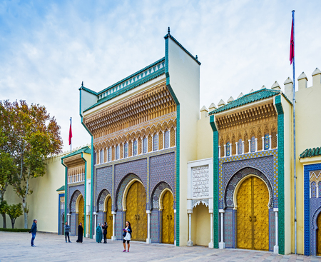 bab: Tourists in front of Bab Makhzen side gates of the Royal Palace in Fez, Morocco. North Africa.