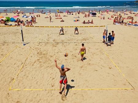 youngs: Youngs mens playing volleyball in the Zurriola beach, San Sebastian, Guipuzcoa. Spain