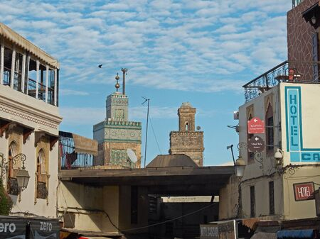 fez: View of Rooftops of the Fez medina with Medersa Bou Inania mosque minaret in background. Fez, Morocco. North Africa. Editorial