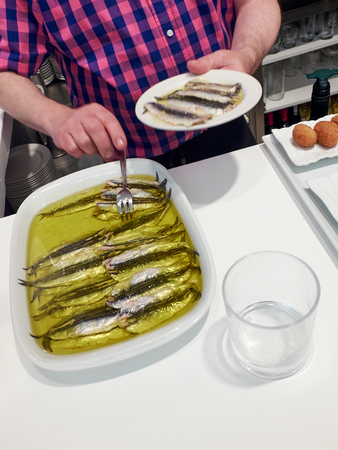 culinary tourism: Spanish Boquerones (anchovies marinated in olive oil).