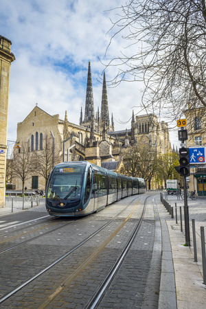 aquitaine: Tram rolling near to Cathedral of St. Andre.Saint Andre is a gothic cathedral of Bordeaux, the capital of Aquitaine. France.
