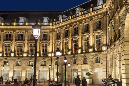 aquitaine: Bordeaux, France - March 24, 2016. People walking in Place de la Bourse square at night. Bordeaux, Aquitaine. France.