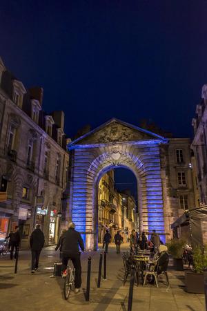 aquitaine: Bordeaux, France - March 27, 2016. Men in bike rolling in Porte Dijeaux. Dijeaux is a city gate in Gironde district of Bordeaux, capital of Aquitaine. France.