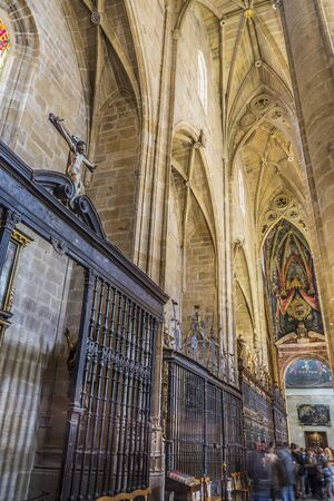 quenching: People in aisle of Co-cathedral of Santa Maria de la Redonda. Way of Saint James made this one of the Most Important cathedrals on the route. Logrono, Spain.