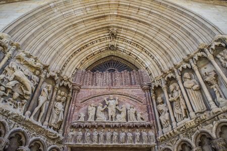 bartolome: The tympanum of Christ Redeemer (Cristo Redentor) in the main facade of San Bartolome church in Logrono, La Rioja. Spain. Stock Photo