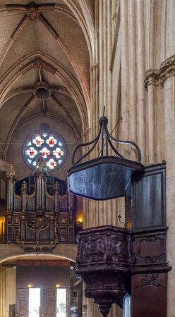 pipe organ: Bayonne, France - May 21, 2016: Pipe organ and pulpit in nave of Cathedral of Sainte-Marie de Bayonne Cathedral.  Bayonne, Aquitaine. France